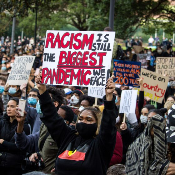 A large group of black protesters to end racism black lives matter